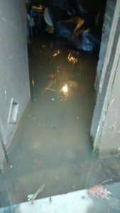 A basement in a house that didn't have gutters and had bad walls. Also this house did not have a sump pump. The combination equals disaster.